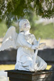 Angel statue on cemetery crying blood tears Royalty Free Stock Photo