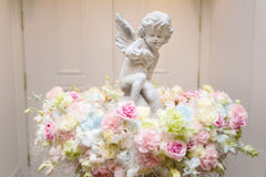 Angel statue with colorful flower Stock Image