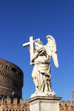 Angel statue with a cross, Castel Sant`Angelo, Rome, Italy. Blue sky Stock Image