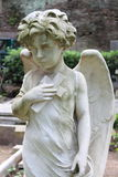Angel statue with cross. In marble stone Stock Photo