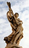 Angel statue with cross, St Angels bridge, Rome. Marble statue of winged angel with cross Stock Photography