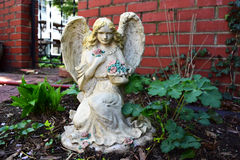 Angel statue in garden Royalty Free Stock Photography