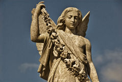 Angel Statue With Garland Stock Photography