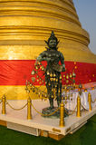 Angel statue with Golden stupa Stock Images