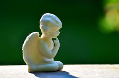 Angel statue. On gravestone in cemetery Royalty Free Stock Photos