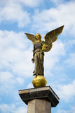 The Angel Statue. Statue of an angel on a high pedestal against the sky Stock Photography