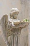 Angel Statue Holding Baptismal Font V stock afbeeldingen