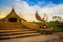 An angel statue holding sphere lamps under cloudy blue sky day i. N front of the Buddhist church in Wat Sirindhorn Wararam Phu Prao, public temple in Ubon Royalty Free Stock Photos