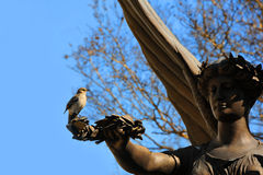 Angel Statue Holds sign of peace an Olive Branch Royalty Free Stock Photo