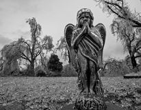 Angel Statue After An Ice Storm. A statue of an angel in an empty lot after a devastating ice storm Royalty Free Stock Image