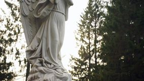 Angel statue on pedestal. Panorama stock video