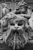 Angel statue in Piazza Navona. Detail of fountain with angel and lion in Piazza Navona, Rome, Italy Stock Photos