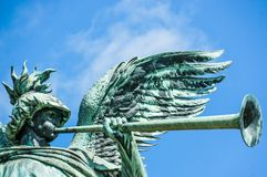 Angel statue playing the trumpet royalty free stock photo