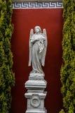 Angel statue raising her gaze to heaven. Statue for marble garden Stock Photo