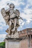 Angel statue in Rome. Angel statue on the Tiber in Rome Stock Image