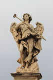 Angel statue in Saint Angel bridge Stock Photo