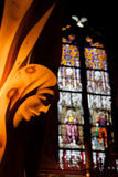 Angel Statue and Stained Glass. An angel statue and stained glass in the Margaret Chapel in Salzburg Austria stock images