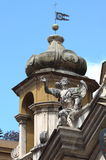 Angel statue on top of baroque church in Rome Royalty Free Stock Photography