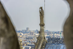 Angel statue at top of Notre-dame Cathedral Stock Photography