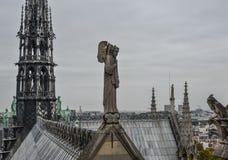 Angel statue on the top of Notre Dame de Paris stock images