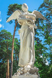 Angel statue with wings on the sky background Stock Photo
