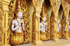Angel statues on the walls. Golden angel. Art wall. Of Buddha temple stock images