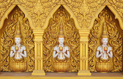 Angel statues on the walls. Golden angel. Art wall. Of Buddha temple Stock Photos