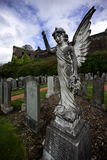 Angel Sterling Castle Graveyard. Angel in Sterling Castle Graveyard Scotland.  In the background is part of Sterling Castle Royalty Free Stock Photo