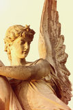 Angel in the sunlight (antique statue) Royalty Free Stock Photography
