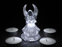 Angel with tea lights Stock Images