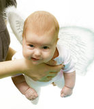 Angel teaches to fly Stock Image