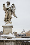 Angel with thorn crown on Sant Angelo Bridge, Rome. Febrary 4, 2012 - Rome (Italy), the rare cold leaves the Italian city Rome blanketed with snow Stock Images