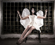 Angel tied to the lattice. Pretty angel tied to the lattice in the dark stock images