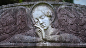 Angel on tombstone on old cemetery Royalty Free Stock Images