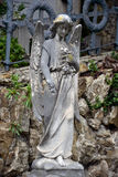 Angel on tombstone on old cemetery. Marble sculpture of angel on a tombstone Royalty Free Stock Photo