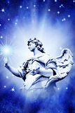 Angel touching star Royalty Free Stock Photo