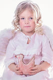 Angel with a toy Royalty Free Stock Image