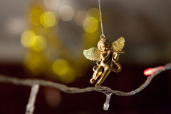 Angel toy on a Christmas Garland Royalty Free Stock Images