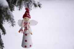 Angel on the tree. Angel with red hat on the tree Royalty Free Stock Photo