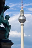 Angel and TV tower. Berlin cathedral bronze angel looking at the TV tower Royalty Free Stock Image
