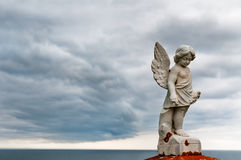 Angel under storm clouds Royalty Free Stock Photography