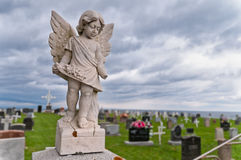 Angel under storm clouds Royalty Free Stock Images