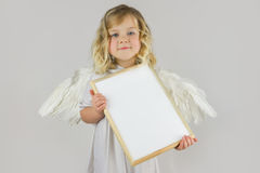 Angel with white blank board Stock Photography