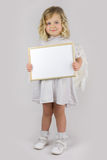 Angel with white blank board Royalty Free Stock Images