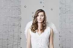 Angel with a white knitted dress Royalty Free Stock Photo