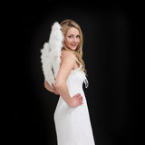 Angel in white visiting us on earth Stock Photos