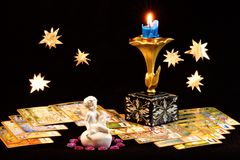 Angel winged love and runes divination by candle light. stock photo