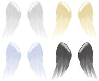 Angel wings. Soft angel wings in white, gold, blue and black isolated on white Royalty Free Stock Photo