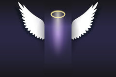 Angel wings with golden halo hovering in the dark Royalty Free Stock Photo