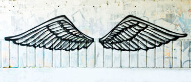 Angel wings. Graffiti painted on street wall stock photos